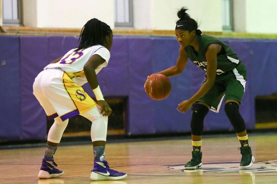 Zhaneia Thybulle of Elmont drives to the basket