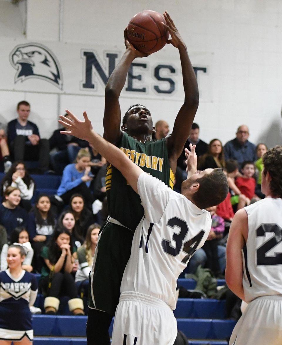 Westbury's Isiah Bien-Aise puts up a shot defended