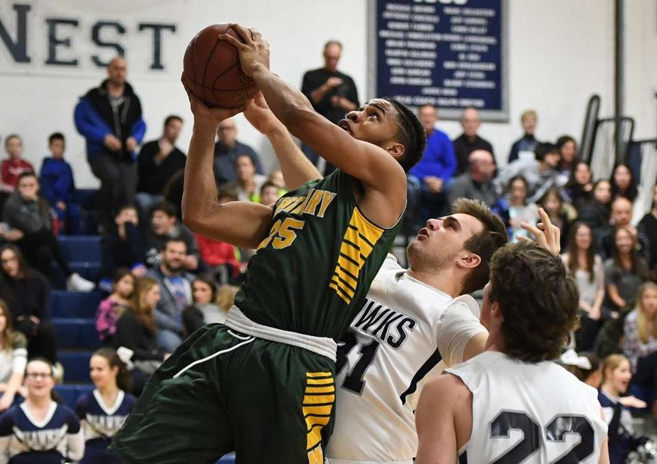 Westbury's Khalid Ketchen is fouled by Plainview-Old Bethpage