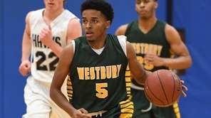 Westbury's Brandon Ottley brings the ball up court