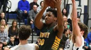 Westbury's Darius Young puts up a basket against