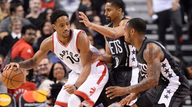 Toronto Raptors guard DeMar DeRozan (10) protects the