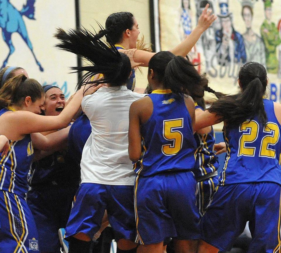 Kellenberg varsity girls basketball teammates hoist Clare Calabro