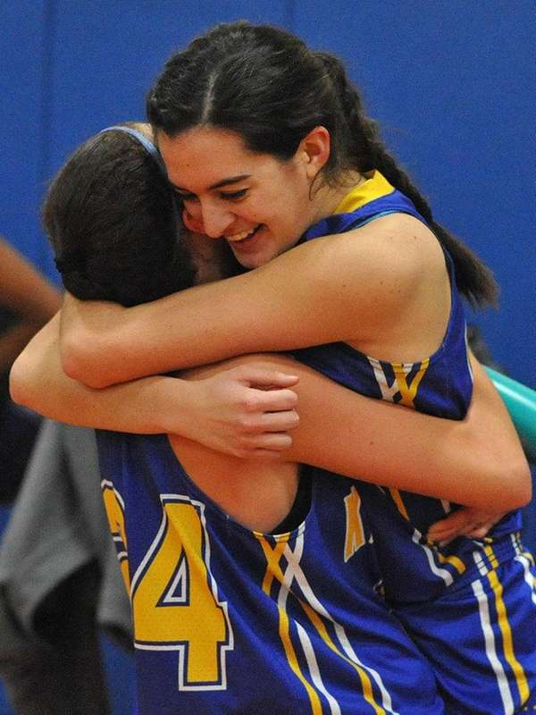 Clare Calabro #10, right, celebrates with teammate #24