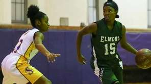 Zhaneia Thybulle of Elmont drives to the basket against