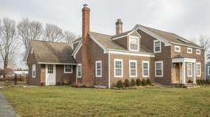 This circa-1830 farmhouse in Aquebogue is listed for
