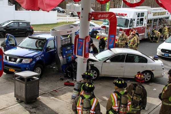 Firefighters respond to a crash on Saturday, Jan.