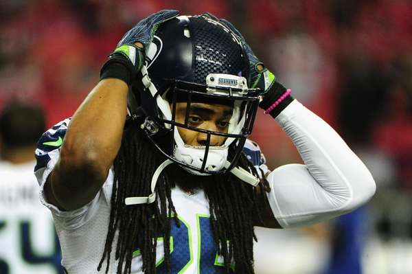 Richard Sherman #25 of the Seattle Seahawks warms