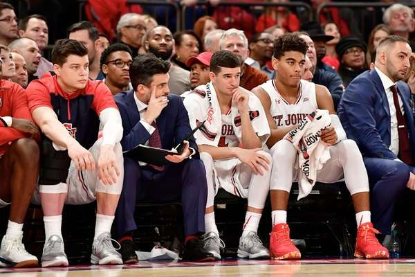 The St. John's Red Storm bench reacts late