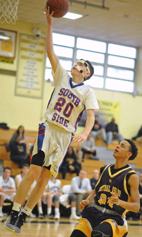 Patrick Basile #20 of South Side drives to