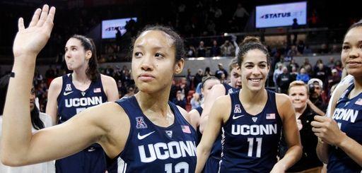 Connecticut guard Saniya Chong (12) and her teammates