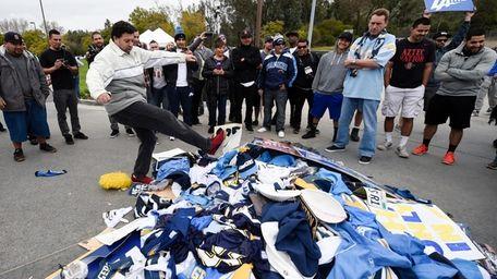 Chris Githens, left, kicks a pile of Chargers