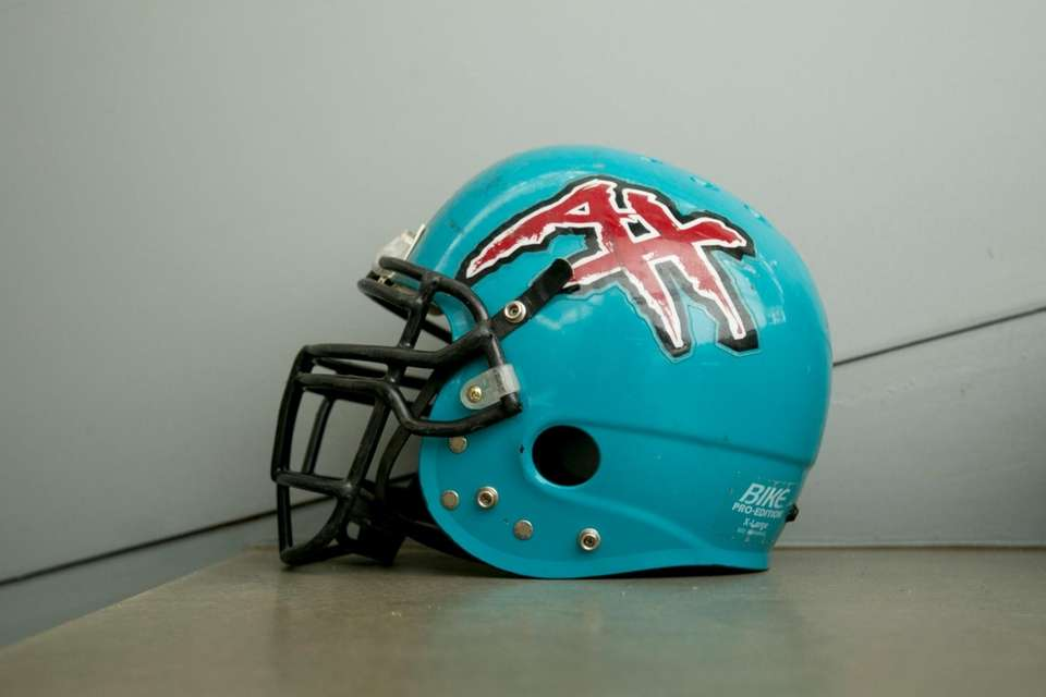 A Memphis Maniax helmet on display at an