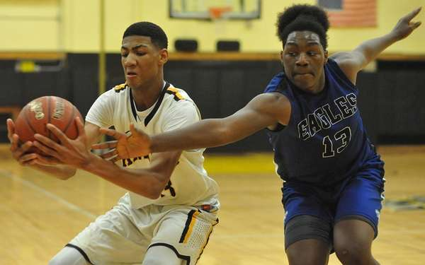 Craig Brown #33 of Uniondale, left, grabs an