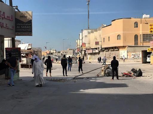 Anti government protestors block the road in the