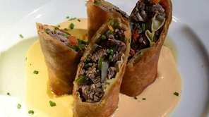 Philly cheesesteak spring rolls are a specialty at