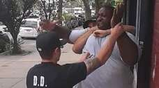 A cell phone frame grab shows the arrest