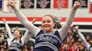 Hewlett varsity cheerleaders compete during the NY State