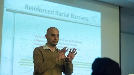 Local historian Christopher Verga speaks to community members