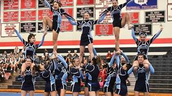 Rocky Point varsity cheerleaders compete during the NY