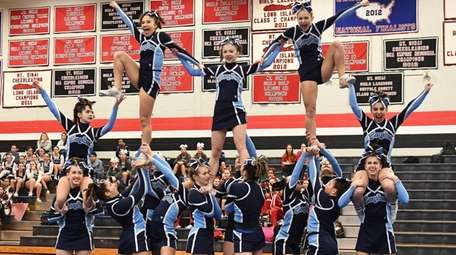 Rocky Point varsity cheerleaders compete during the Mount