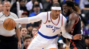 New York Knicks forward Carmelo Anthony (7) leans