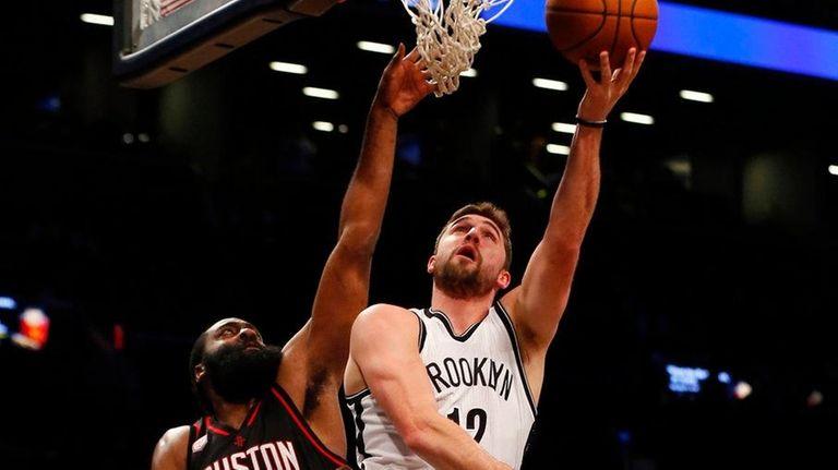 Joe Harris of the Brooklyn Nets goes to