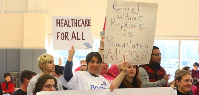 About 1,500 people rallied in New Cassel on