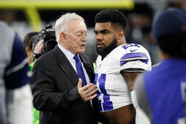 Dallas Cowboys owner Jerry Jones talks with Ezekiel