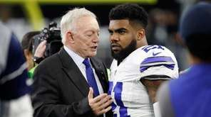 Dallas Cowboys owner Jerry Jones talks with Ezekiel