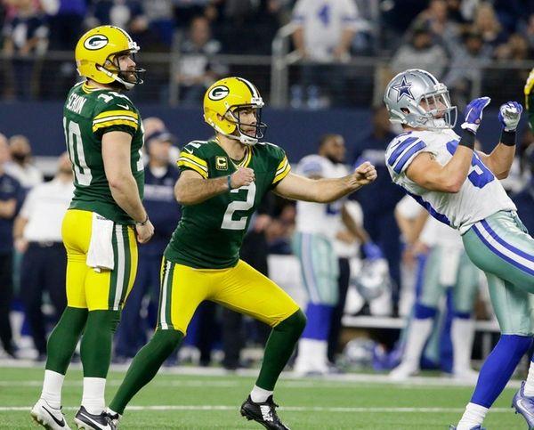 Green Bay Packers' Mason Crosby (2) watches his