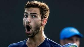 Noah Rubin in action against Bjorn Fratangelo during