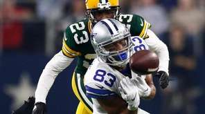Dallas Cowboys' Terrance Williams loses the ball against Green
