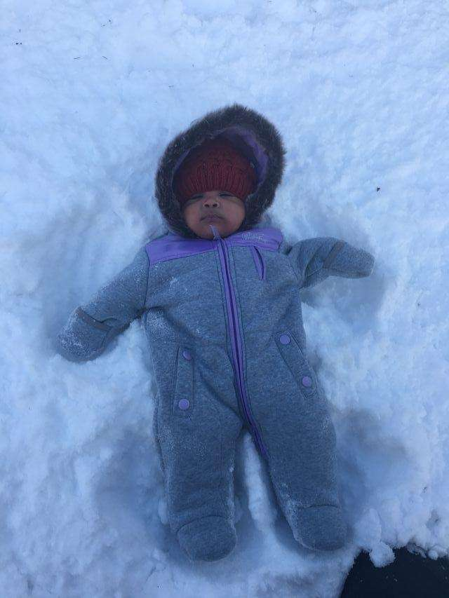 Charlotte makes her first snow Angel