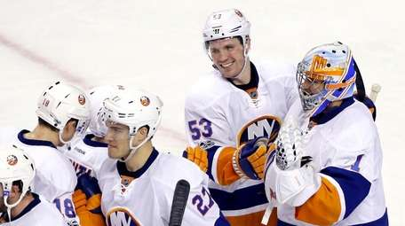New York Islanders center Casey Cizikas (53) smiles