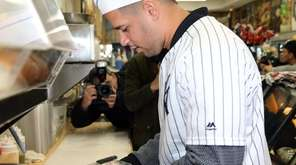 Yankees Gary Sanchez prepares sandwiches at the Bullpen