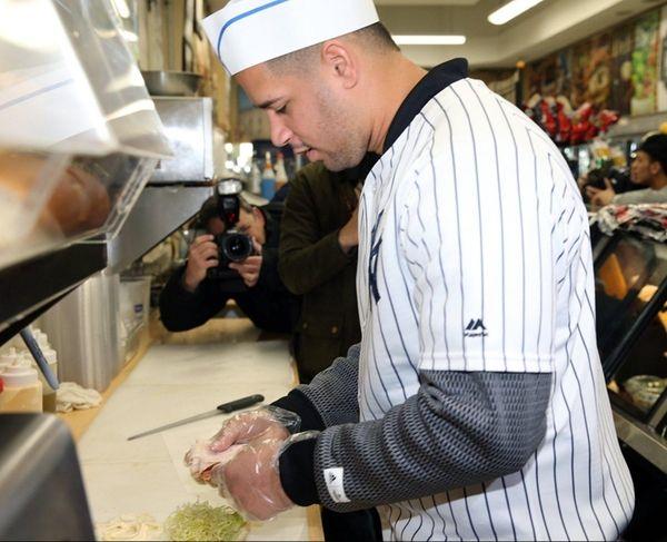 Yankees' Gary Sanchez prepares sandwiches at the Bullpen