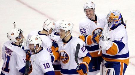 New York Islanders center Casey Cizikas (53) smiles