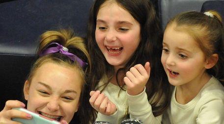 Matison Kindelmann, 6, center, and sister Charlotte Kindelmann,