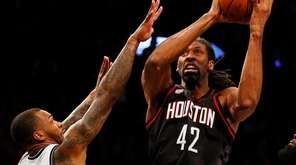 Nene Hilario #42 of the Houston Rockets goes