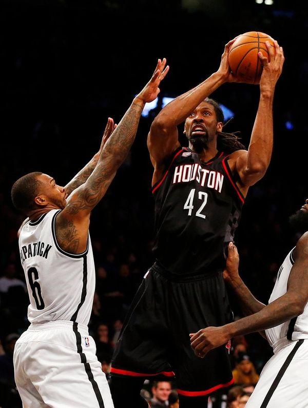 Nene Hilario #42 of the Houston Rockets goes