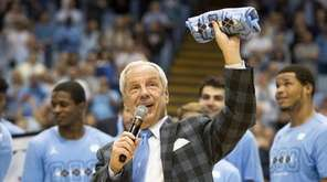 North Carolina head coach Roy Williams speaks to