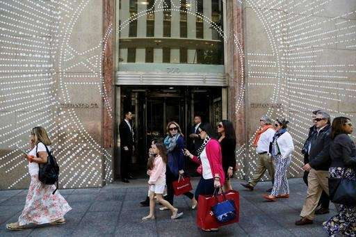 Shoppers walk by Tiffany & Co.'s Fifth Avenue