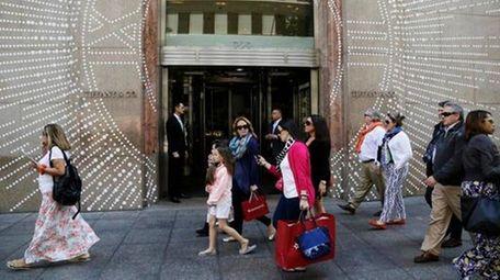 Shoppers walk by Tiffany & Co.'s Fifth Avenue