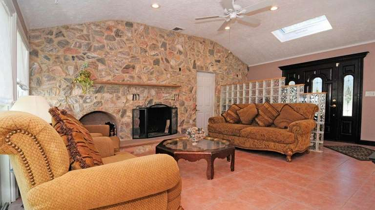 This Commack ranch has three bedrooms and two