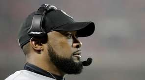 Pittsburgh Steelers head coach Mike Tomlin watches from