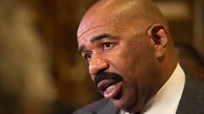 Steve Harvey speaks with the media on Jan.