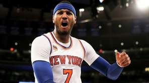 The New York Knicks' Carmelo Anthony reacts to