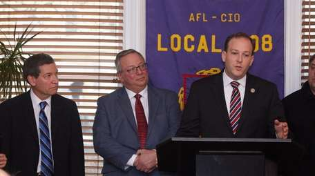 Roger Clayman, left, executive director of the Long