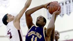 Central Islip's Christian Cherry (41) drives to the